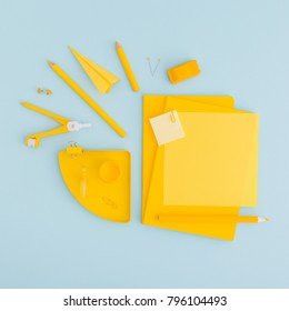 School or office background with stationery, notebook paper, sticky note, pen, ruller paper clip on blue and yellow colors. Flat lay.