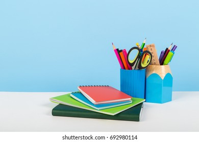 School office stationery on white table blue background