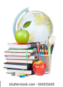 School and office supplies. Notepads, colorful pencils, apple and globe. Isolated on white background
