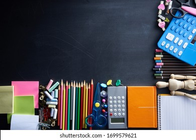 School and office supplies on blackboard background. Top view with copy space