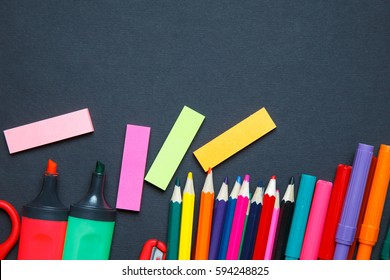 School and office supplies on blackboard background.