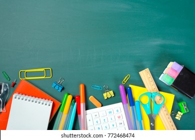 School and office supplies on blackboard