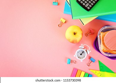 School and office supplies on a pink background. Back to school. School flat lay. Copy space for text. School background.