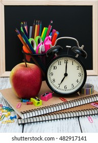 School office supplies on the wooden table