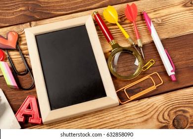 School office supplies on wooden background