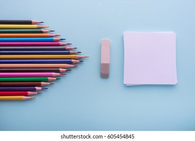 School and office supplies. Top view. Isolated on cyan background with copy space