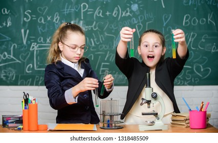 School project investigation. School experiment. Girls school uniform excited proving their hypothesis. School for gifted children. Gymnasium students with in depth study of natural sciences.