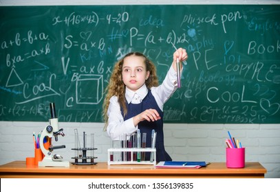 School pupil study chemical liquids. School chemistry lesson. Test tubes with substances. Formal education. Future microbiologist. School laboratory. Girl smart student conduct school experiment.