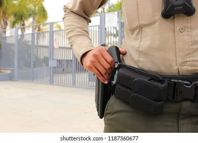 School safety concept - armed police officer on duty protecting a closed campus high school in California