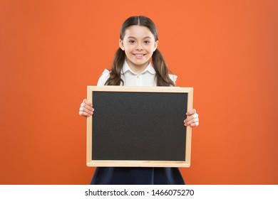school sales. back to school. happy teachers day. 1 september. small girl demonstrate announcement. happy small school girl with chalkboard. blackboard for copy space. information. write hometask.