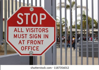 School security concept - A sign at a closed high school campus alerts visitors that they need to sign in