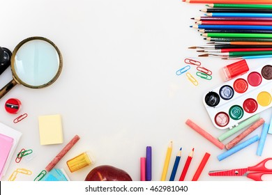 School set with notebooks, pencils, brush, scissors and apple on white background