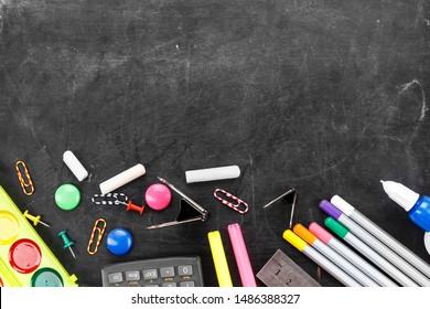 school set stationery on a black school blackboard. place for text.