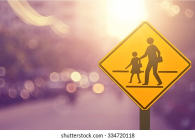 School sign.Traffic sign road on blur road abstract background.
