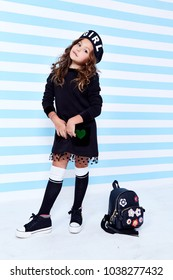 School small baby girl dress for schoolgirl pupil uniform bag beret socks hat fun smile curly hair toy  studies learning fashion stile clothes child childhood little model cute face pretty strip wall.