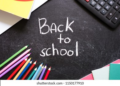 School stationery around Back to School words on slate black background. Back to school concept. Top view. Copy space. Free space. Ready for school.