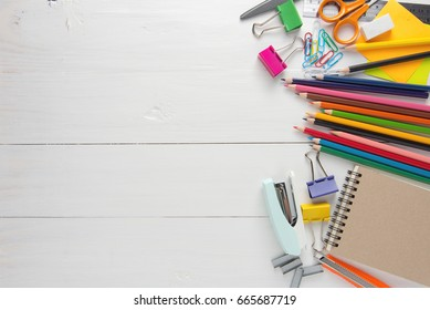School stationery and office tools on wood table.
