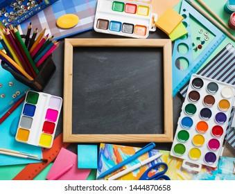 School stationery on background blackboard