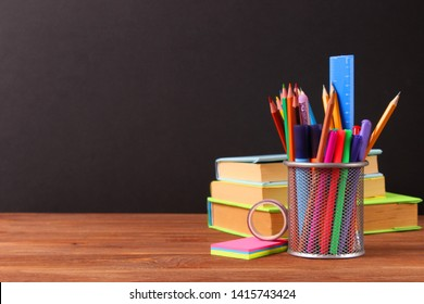 School stationery on the background of the school board. Concept back to school. Place for text