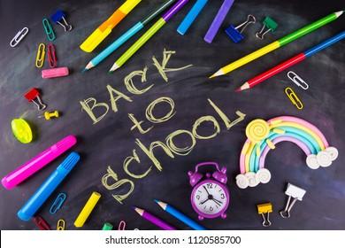 School stationery on blackboard framing, back to School