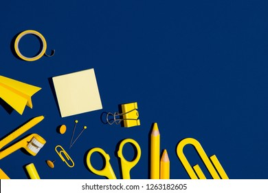 School stationery on a navy blue and yellow color background. Back to school creative illustration, template.