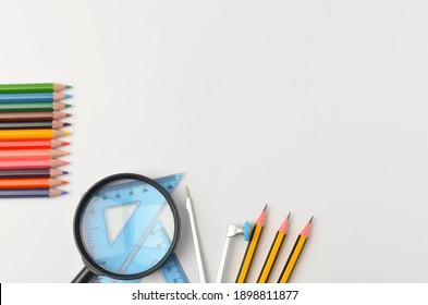 School stationery on a white background. Back to school concept. Selective focus.