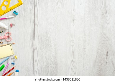 School stationery on wooden background. Back to school creative layout, template with copy space. Flat lay, top view, overhead