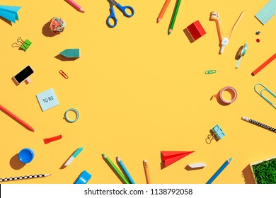 School stationery over colorful yellow backdrop. Flat lay.