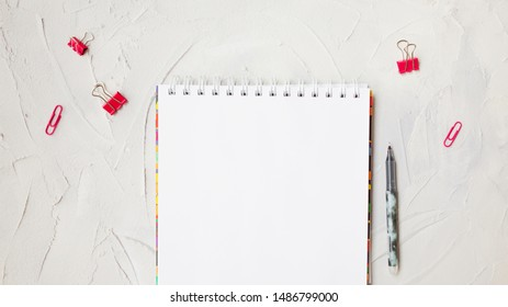 School still life about studying, an empty sheet for notes or to-do list. Gray textured background, stationery
