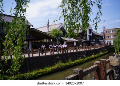 """School student are taking photo beside river at Sawara, Japan. Sawara is tourist site as it remains old architecture called """"Koedo"""" which means """"Small edo"""". Edo is Japanese old era."""