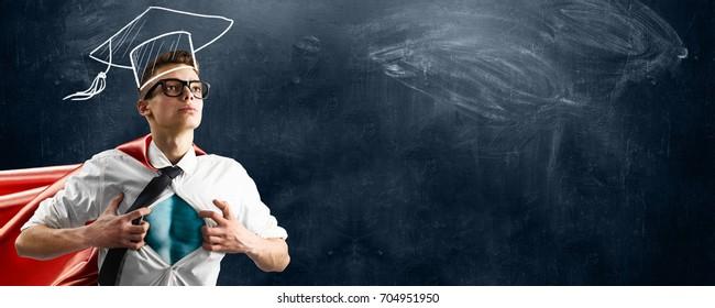 School superhero standing against blackboard