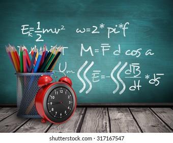 School supplies against green chalkboard
