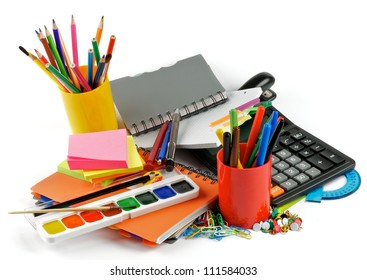 School supplies. Ballpoint Pens, Colored Pencils, Paintbrush, Felt Tip Pens, Pencil Sharpener, Watercolor Paints, Paper Clips, Calculator, Stapler, Ruler, Protractor, Notebooks and Sticky Notes
