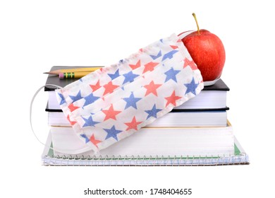 school supplies books apple and covid 19 mask for coronavirus isolated white background