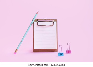 School supplies clipboard, pen and binder on pink background. Mock up clipboard. School banner 2020. Back to school. Top view. Space for text. Place for text
