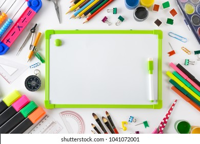 School supplies with flipchart on white. Top view.