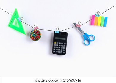 School supplies hang on the rope. School supplies on white background. Back to school concept