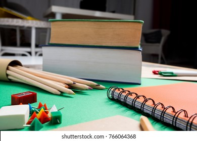 School supplies lying on the green table