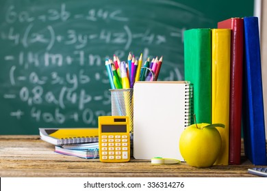 School supplies on the background of the school board