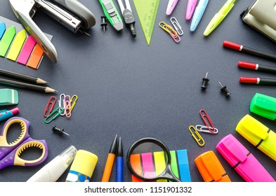 School supplies on a black background