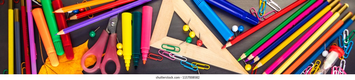 School supplies on black board background with Stationery. Back to school, office concept. Flat lay, copyspace