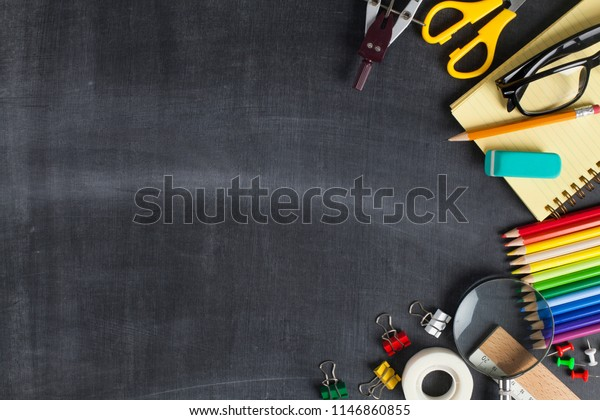 School supplies on black board background. Back to school concept