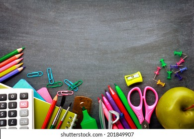 School supplies on blackboard background ready for your design