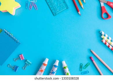 School supplies on blue background minimal creative back to school concept. Space for copy.