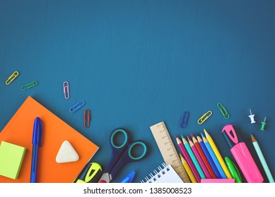 School supplies on blue background. Top view. Copy space.