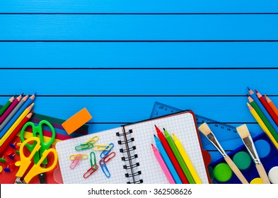 School supplies on blue wooden table