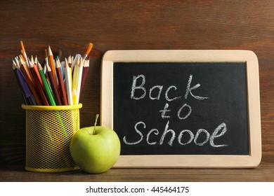 School supplies on brown wooden background