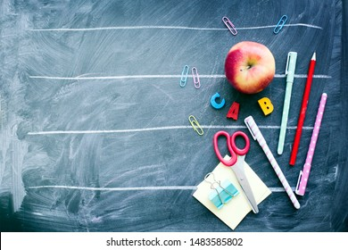 School supplies on a chalkboard background/top view/ Education, back to School background concept with copyspace.