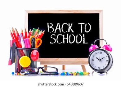 School supplies on chalkboard with text Back to School