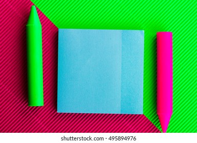 School supplies on colored background.
